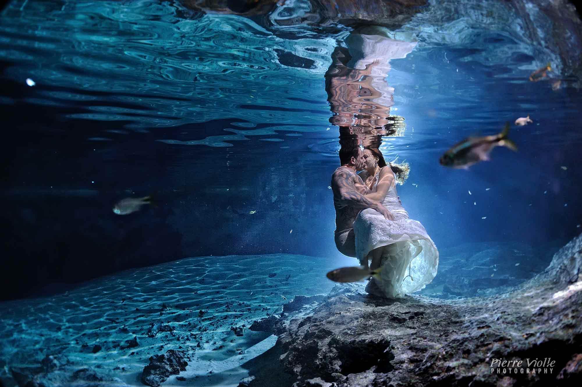 underwater trash the dress in a cenote-bride & groom portrait